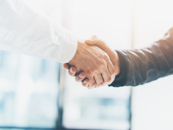 Dekofoto, istock. Business partnership meeting. Picture businessmans handshake. Successful businessmen handshaking after good deal. Horizontal, blurred